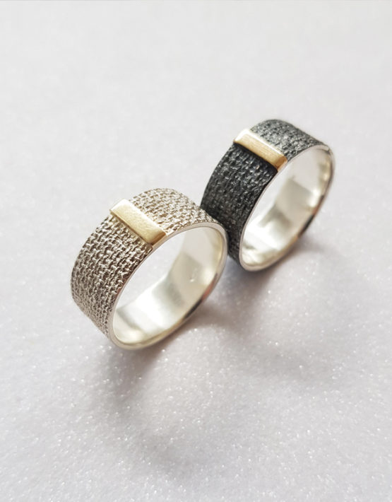 wide sterling silver ring with gold