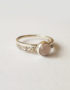 braided silver ring with rose quartz cabochon