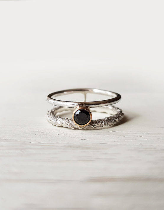 double silver ring with black stone