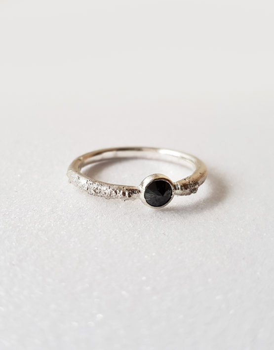 rough silver ring with black gemstone