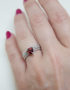 sterling silver ring with garnet trillion cut gemstone
