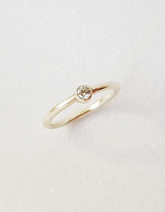 modern white gold proposal ring with genuine diamond