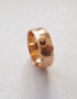 edged rose gold ring with gemstone